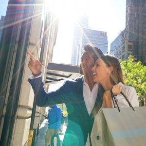 Happy smiling couple shopping on a sunny day in New York