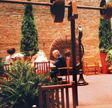 Guests seated at the courtyard and patio of the Fitzpatrick Grand Central.