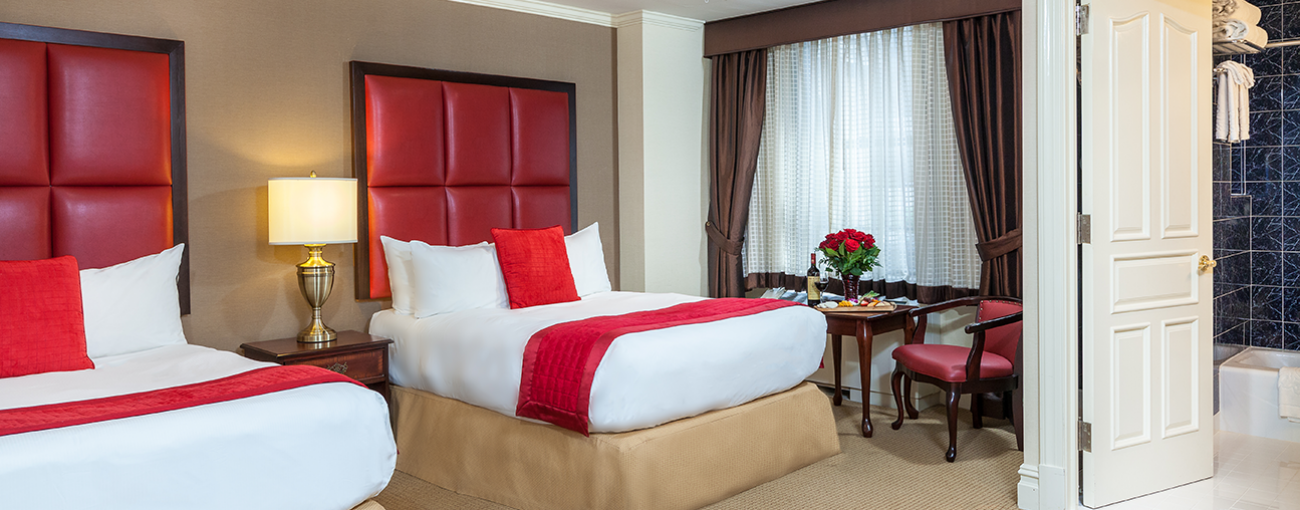 Deluxe rooms feature a work desk and private bath with upgraded amenities.
