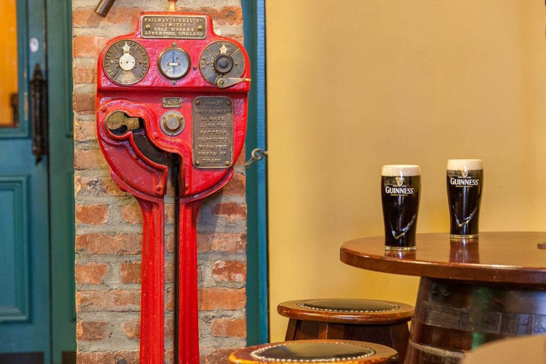 Two pints of Guiness beer on table at Wheeltapper bar.