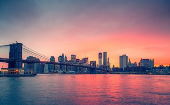 Sunset view of Manhattan bridge from the East River in New York City