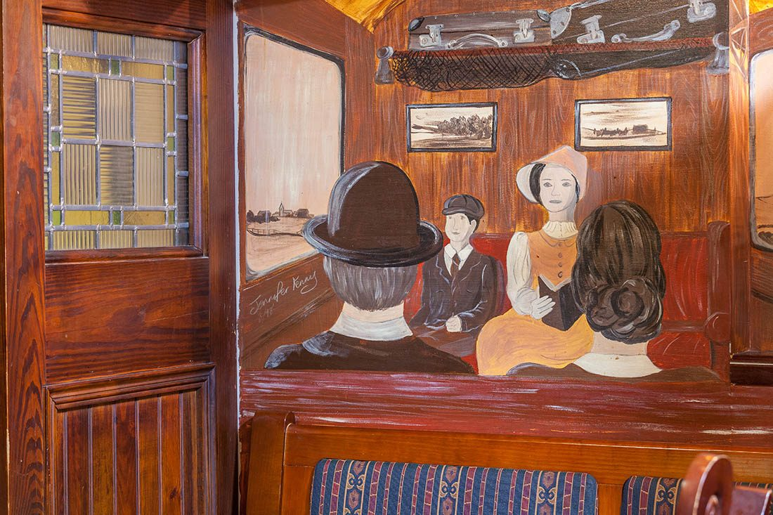 Jennifer Kerry's painting of rail passengers featuring a young boy, young lady and faceless gentleman and woman.