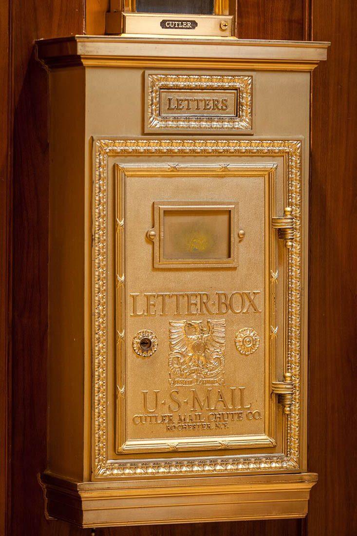 Ornate golden U.S letter box
