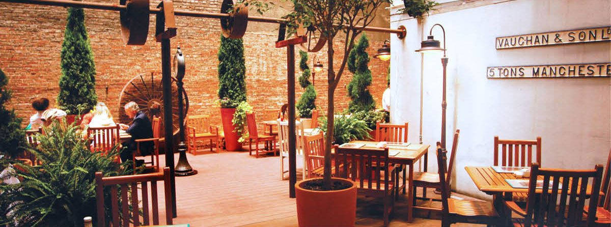 The Wheeltapper Pub and Patio area decorated with towering pot plants and terracotta pots.