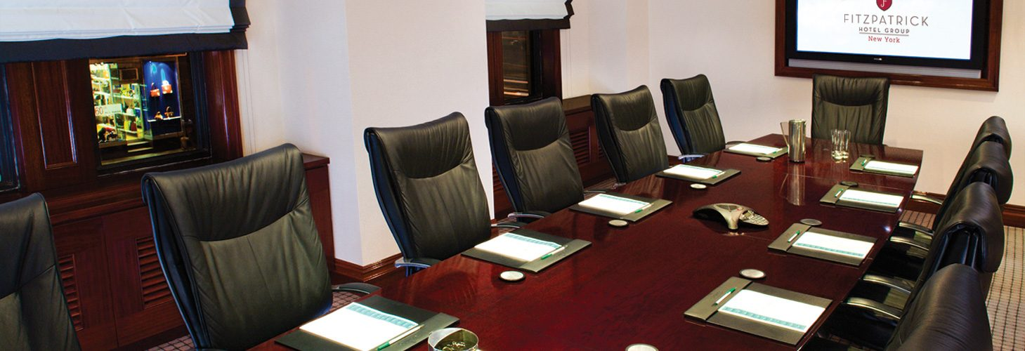 Fitzpatrick Manhattan Hotel dark wood boardroom table and leather chairs with clipboards and pens