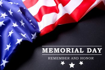 American flag on black surface with Memorial day text