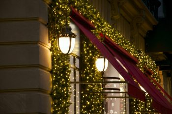 Christmas lanterns with decorative garland with light in the street of New York City