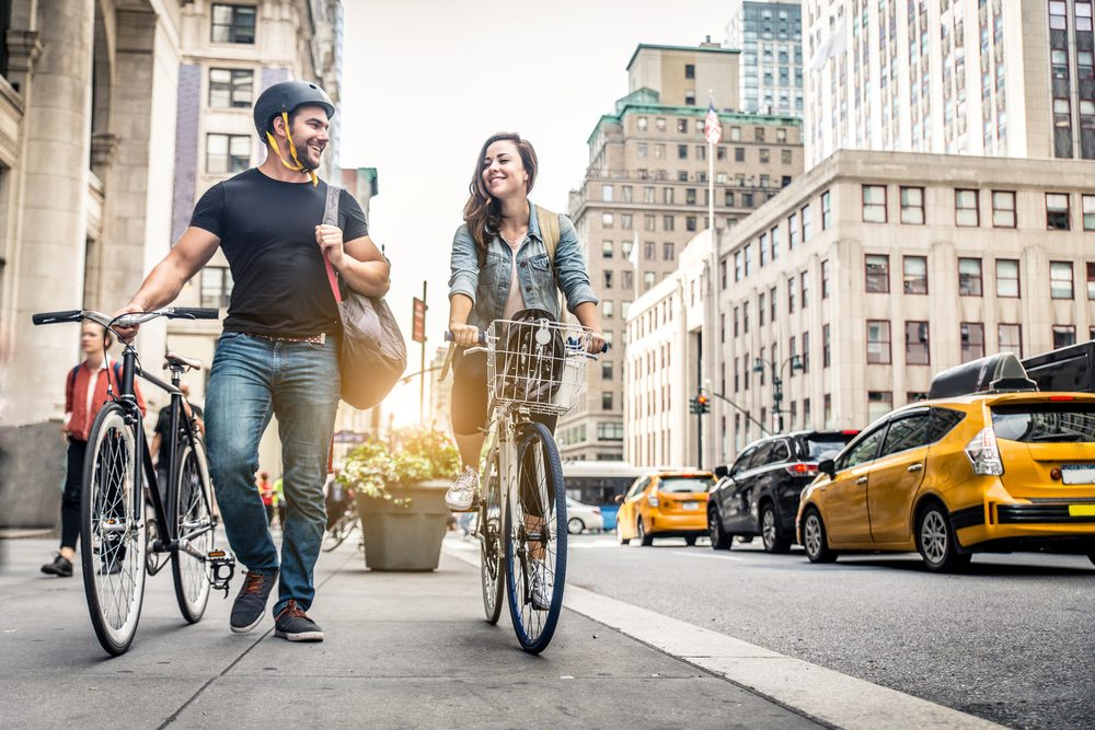 Smiling biking couple on the streets of New York